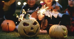 Pumpkins during halloween and children in the background