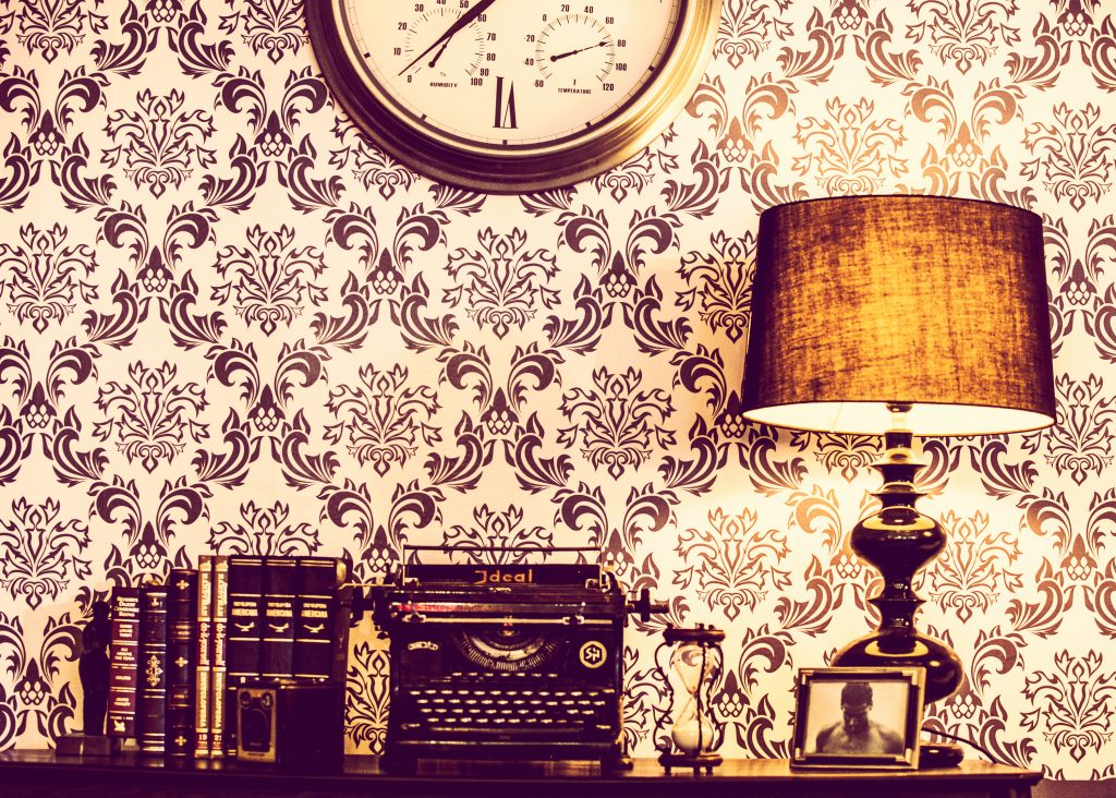 canva-brown-wooden-table-lamp-beside-of-black-typwriter