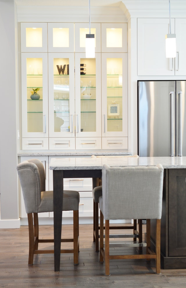 Close off shelving in your kitchen to create a visible or invisible pantry