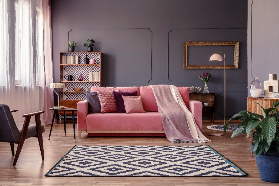 A pink couch that pops in this living room