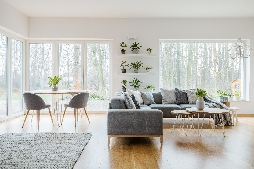 An L-shaped couch in a light-filled living room