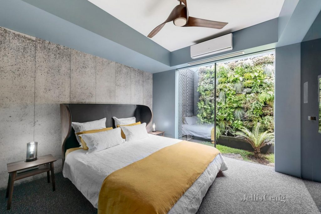 A stylish bedroom with calming blue feature walls.