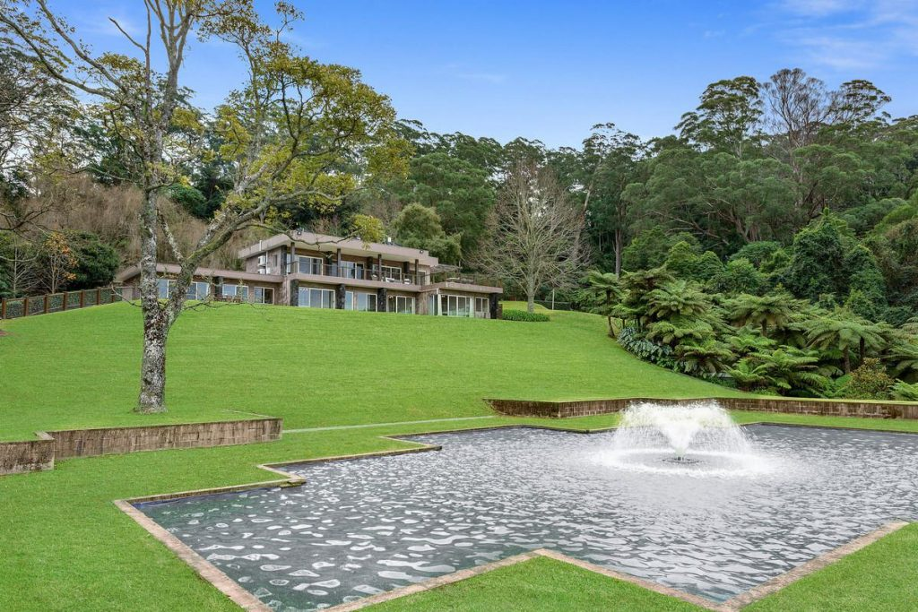 A luxury home in Berry, new South Wales with a water feature out the front