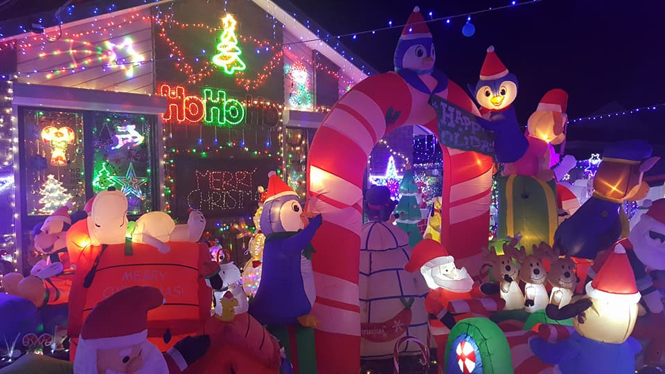 A home with a Christmas display including inflatable characters.