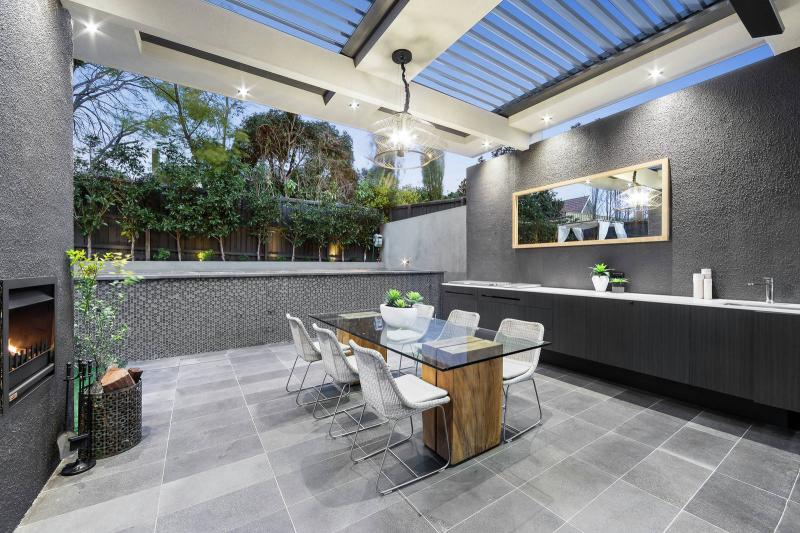 Outdoor alfresco complete with sink and fireplace