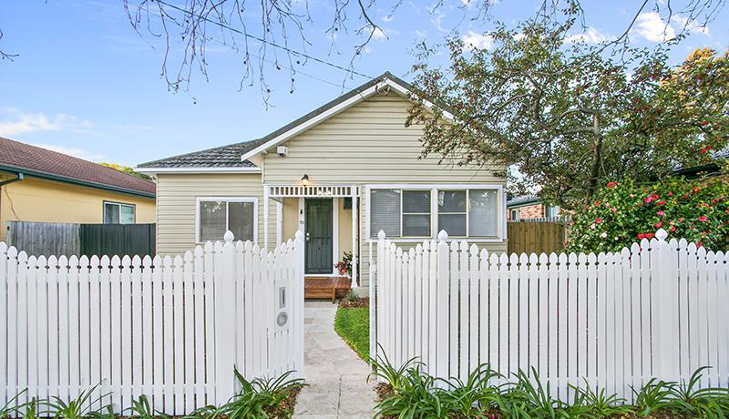 A charming older home with white picket fence