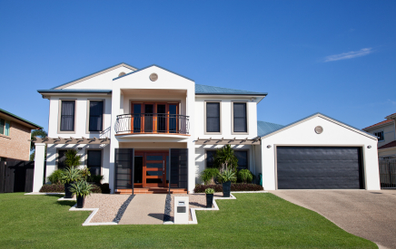 A double storey home with neat lawn.