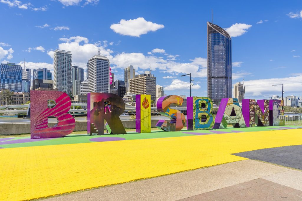 Brisbane, Australia - September 25, 2016: View of Brisbane sign with skyscrapers in the background in South Bank, Brisbane during daytime.