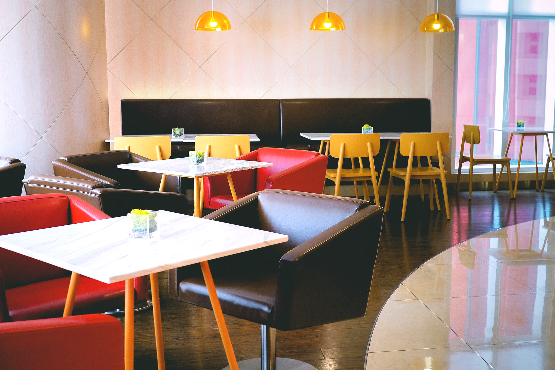 A 60s-inspired diner design with bright yellow, red and brown seating