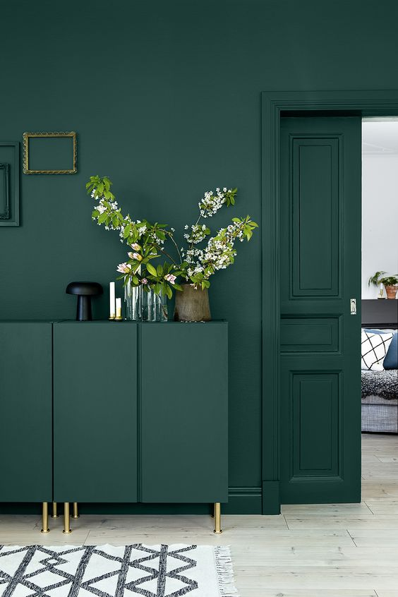 A home interior painted dark green.
