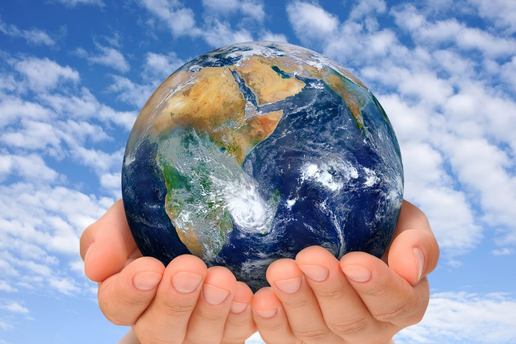 A person holds the world in their hands