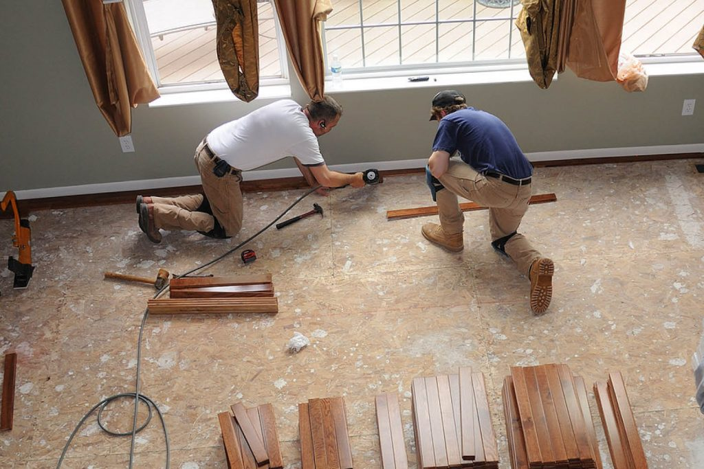 Two workers complete a home renovation