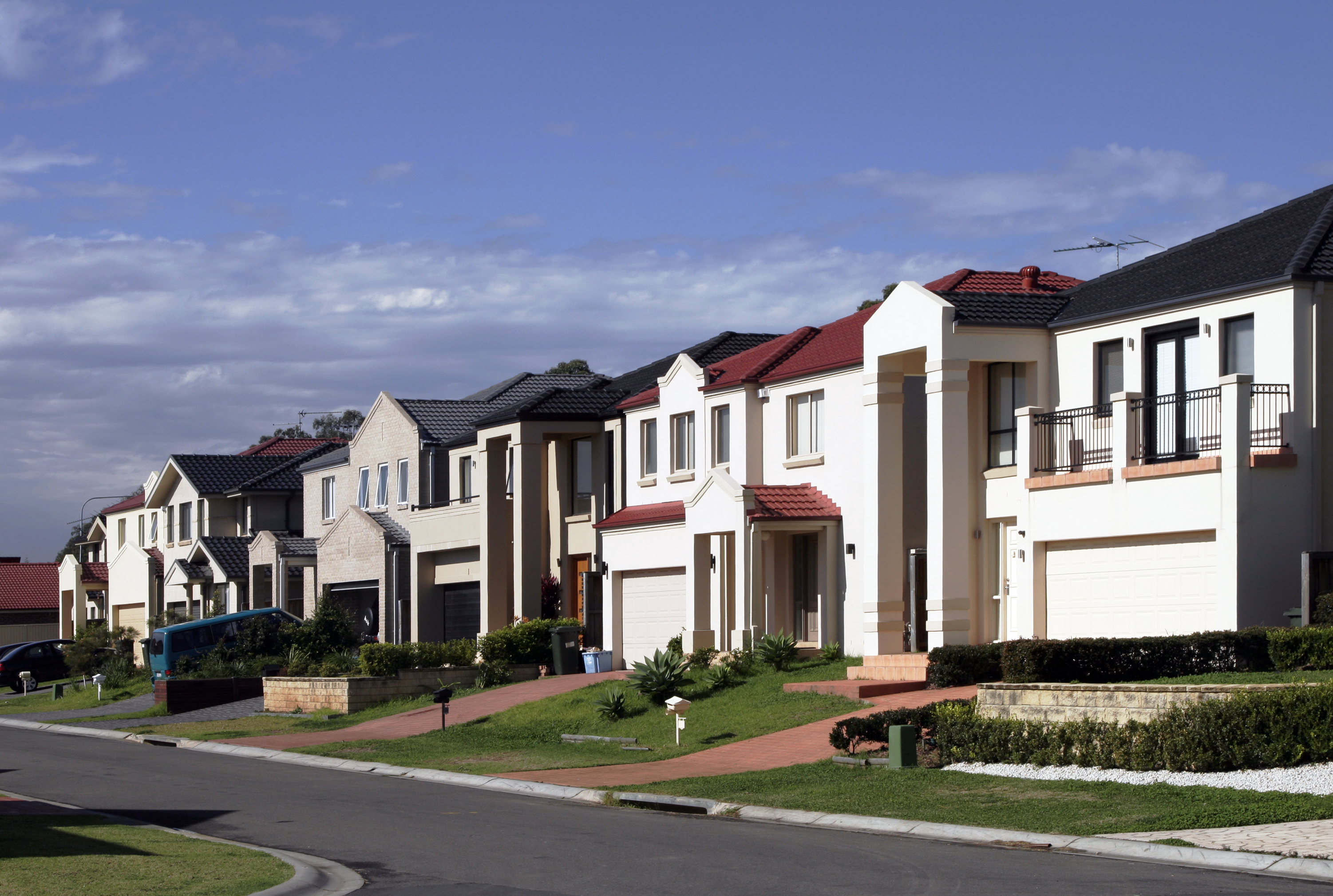 Suburban Street With New Modern Houses In A Sydney Suburb On A Sunny Summer Day, Australia