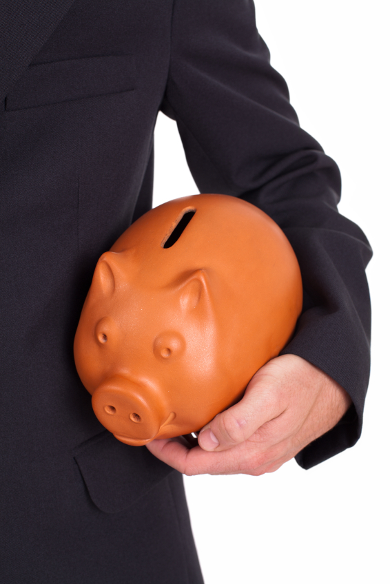 Piggy bank represents interest rates held by the Reserve Bank
