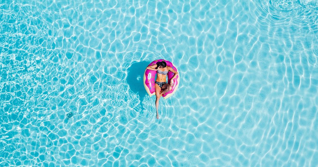 A woman floats in a pool.