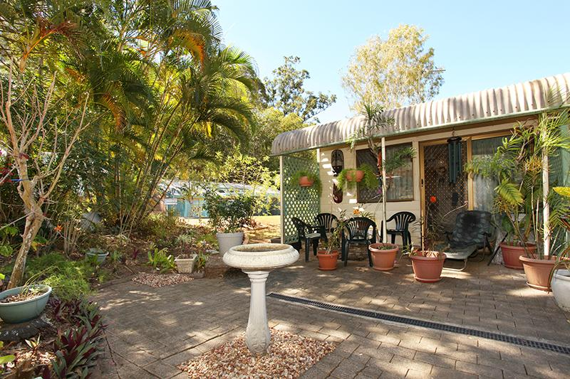 One of the bargain Sunshine Coast homes with a beautiful front yard.