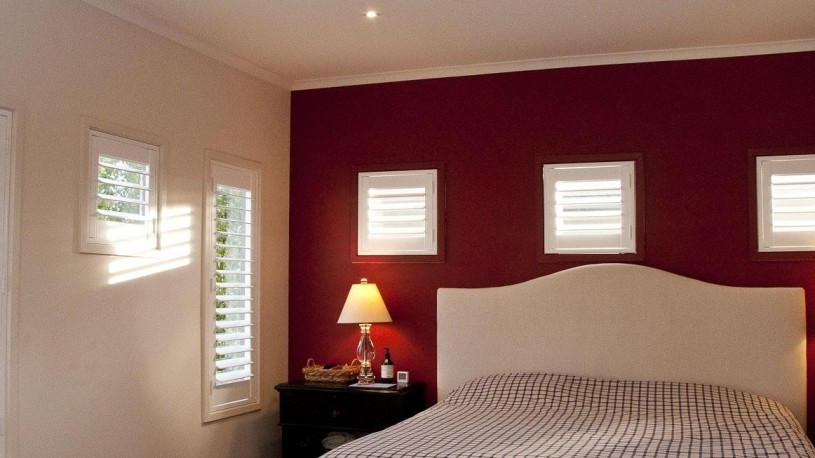 Various Custom Sized Window Plantation Shutters Installed in Master Bedroom