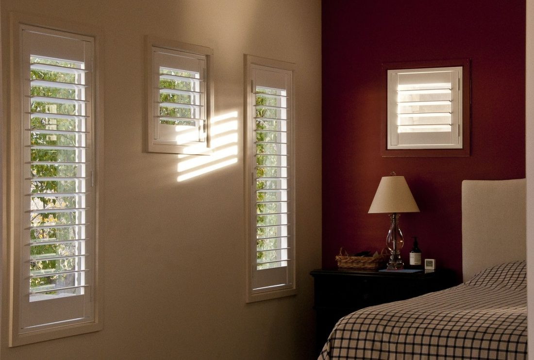 Plantation Shutters Installed in Bedroom with Window Shutters Open