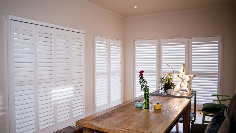 Plantation Shutters installed in Dining Area Semi-Closed for Reduced Light