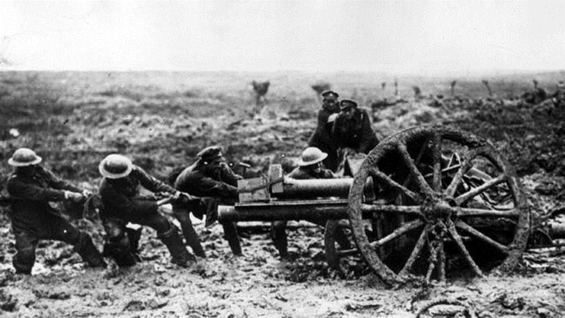 soldiers hauling a field gun out of mud