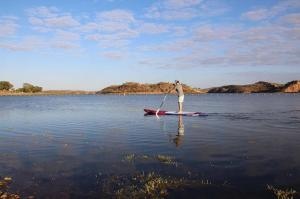 Go to SUPing at Lake Moondara, Mount Isa QLD