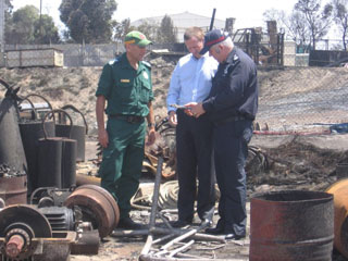 Minister for Emergency Services the Hon Michael Wright and Chief Officers Euan Ferguson and Grant Lupton inspect the damage caused by the recent fires at Proper bay, Port Lincoln
