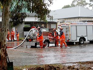 SES volunteers help with localised flooding on South Terrace in Adelaide.