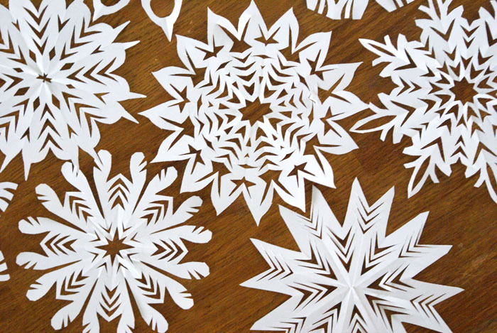 want to keep the kids busy over the christmas break here are three simple ways to incorporate pretty hand cut snowflakes into your holiday design this - Snowflake Christmas Decorations