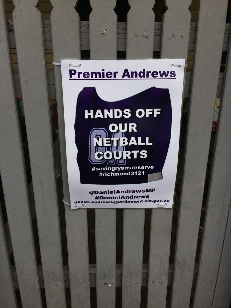 A poster on a gate in Richmond protests state plans to trade the land used as netball courts on Swan Street to build a new Richmond High School. Tod Jones
