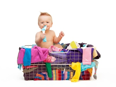 Toddler in basket with clothes