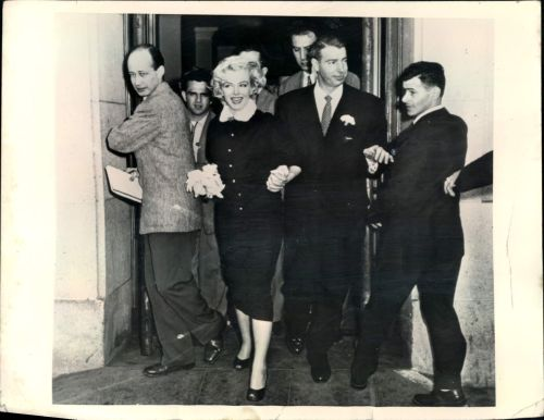 Never one for 'rules,' Marilyn Monroe wore a dark brown, fur-collared suit when she married Joe DiMaggio