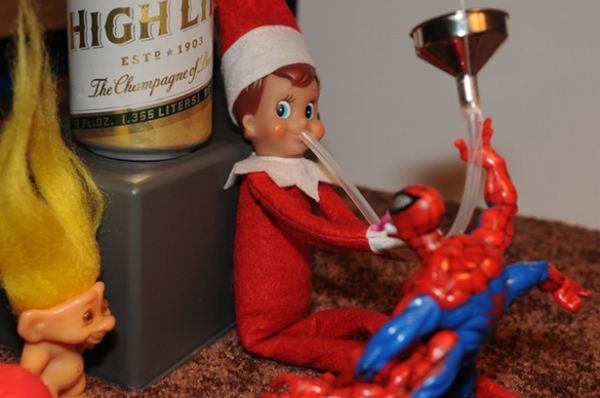 Elf and Spidey share a beer bong