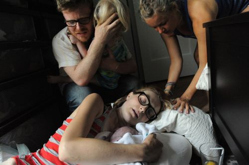 Jen Carnig holds her son, Wiley Lavoie, immediately after his birth as her husband Dan Lavoie, daughter Olive Lavoie, and best friend Lisa Johnson look on. Carnig gave birth at home in Brooklyn, NY. Source: Alice Proujanksky Photography