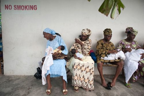 Mothers wait for their newborns to be vaccinated at the Doctors Without Borders-run Aiyetoro Health Centre in Lagos, Nigeria. Source: Alice Proujanksky Photography