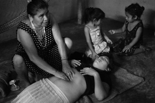 Midwife Elsa Gonzalez Ayala shows CASA Midwifery School students how to perform a traditional Mayan massage used to shrink a woman's uterus and reduce postpartum bleeding. The students traveled to Chunhuhub, Quintana Roo, Mexico to learn traditional midwifery. Source: Alice Proujanksky Photography