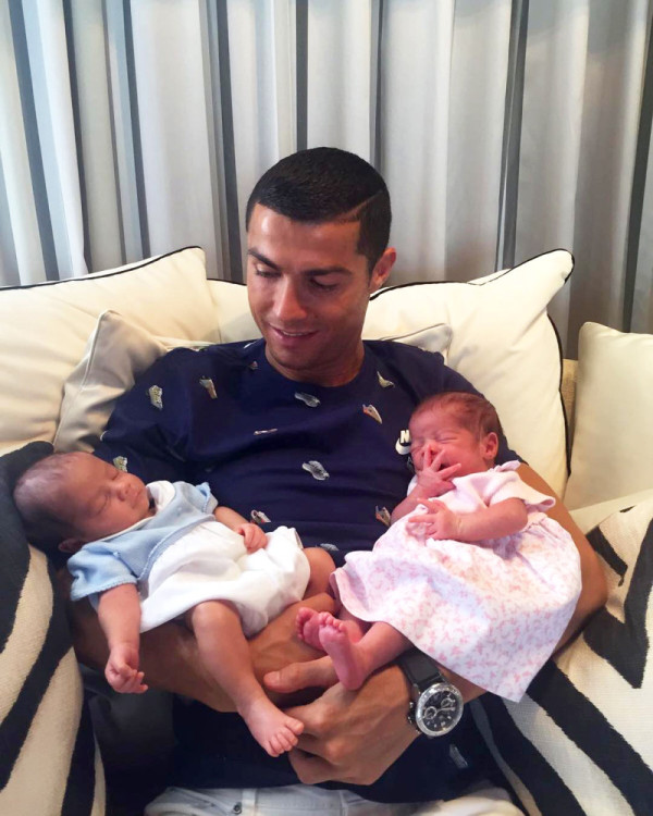 Cristiano holding his new born twins