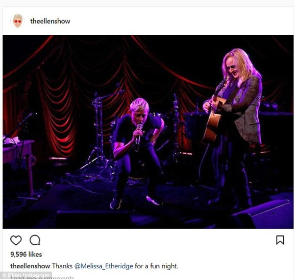 Ellen rockin' out onstage with Melissa Etheridge.
