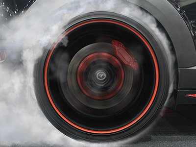 car tyres spinning with smoke drag race