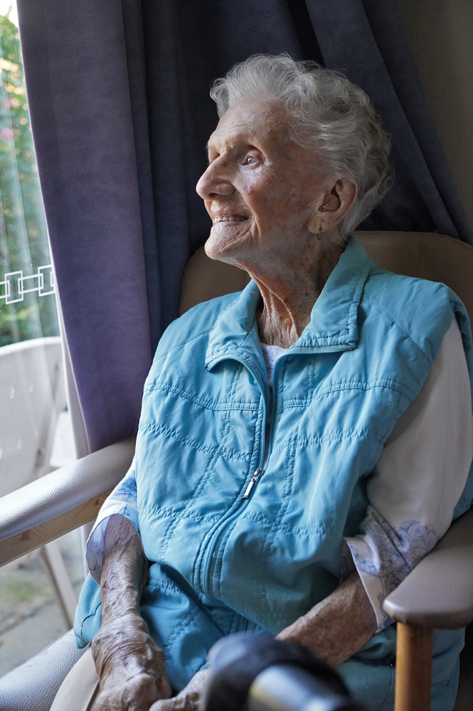Bobby, aged 90, sits by a window reminiscing on her WWII service