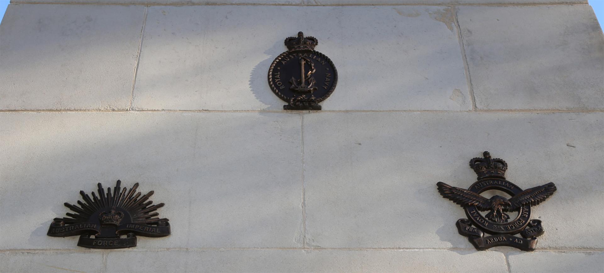 Gosford Cenotaph, close-up of service branch emblems