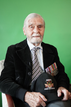 Current photo of a seated Robert Marshall against a green background