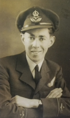 A black and white portrait photo of Tony Adams in uniform as a Pilot Officer