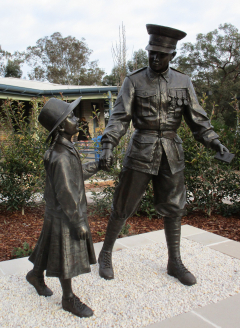 Wollondilly Anglican College Anzac Memorial Shelter and Statue of a First World War veteran holding the hand of a little girl