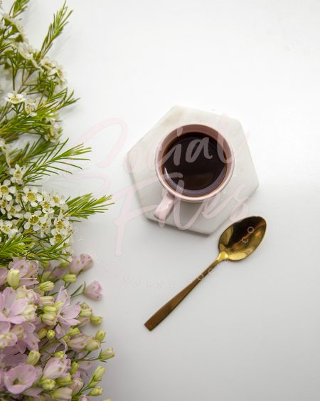 Coffee in pink espresso cup, with pretty florals - watermarked image
