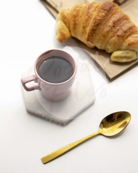 Coffee in pink espresso cup, with croissant - watermarked image