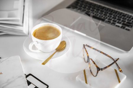 Laptop, diary, glasses, coffee on white desk flatlay #1 (watermarked)