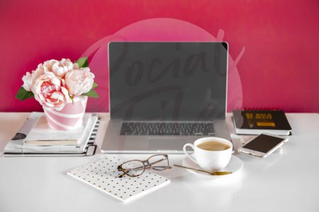 Laptop, diary, iphone, glasses, coffee and flowers on white desk with hot pink background. (watermark)
