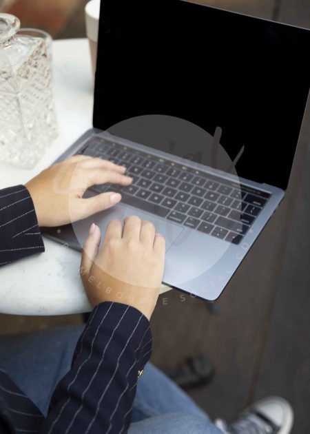 Woman typing on laptop 04 (watermarked)