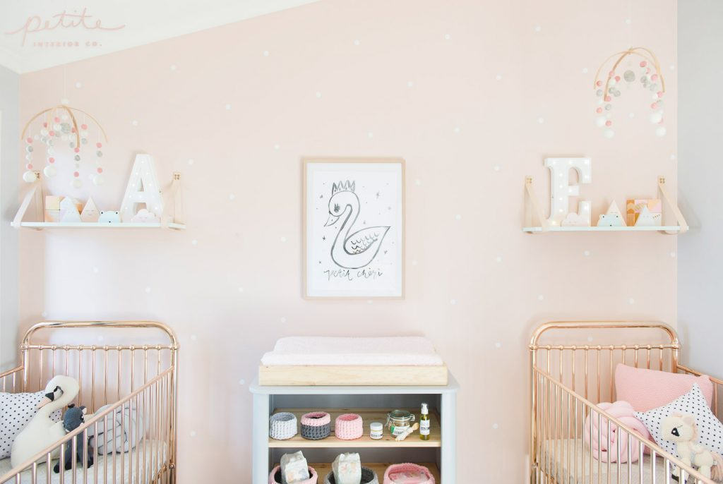 Evie and Aria's nursery room with rose gold cots and baby pink decor