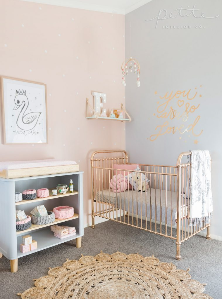 Evie and Aria's newborn nursery room with delicate decor and pink and blue colours